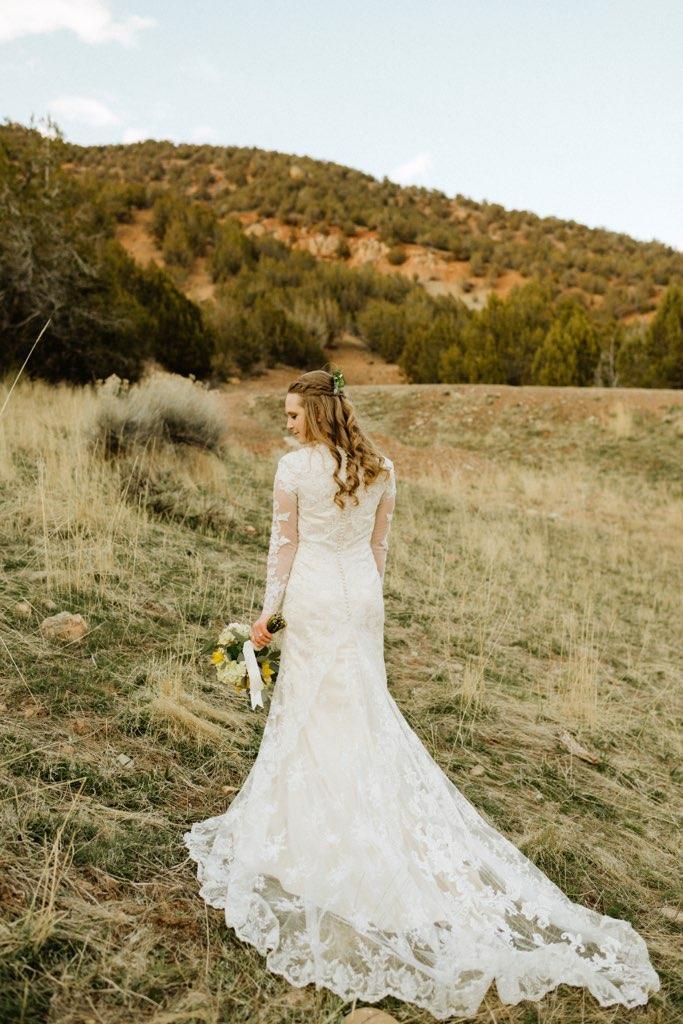 a beautiful bride walking towards a mountain