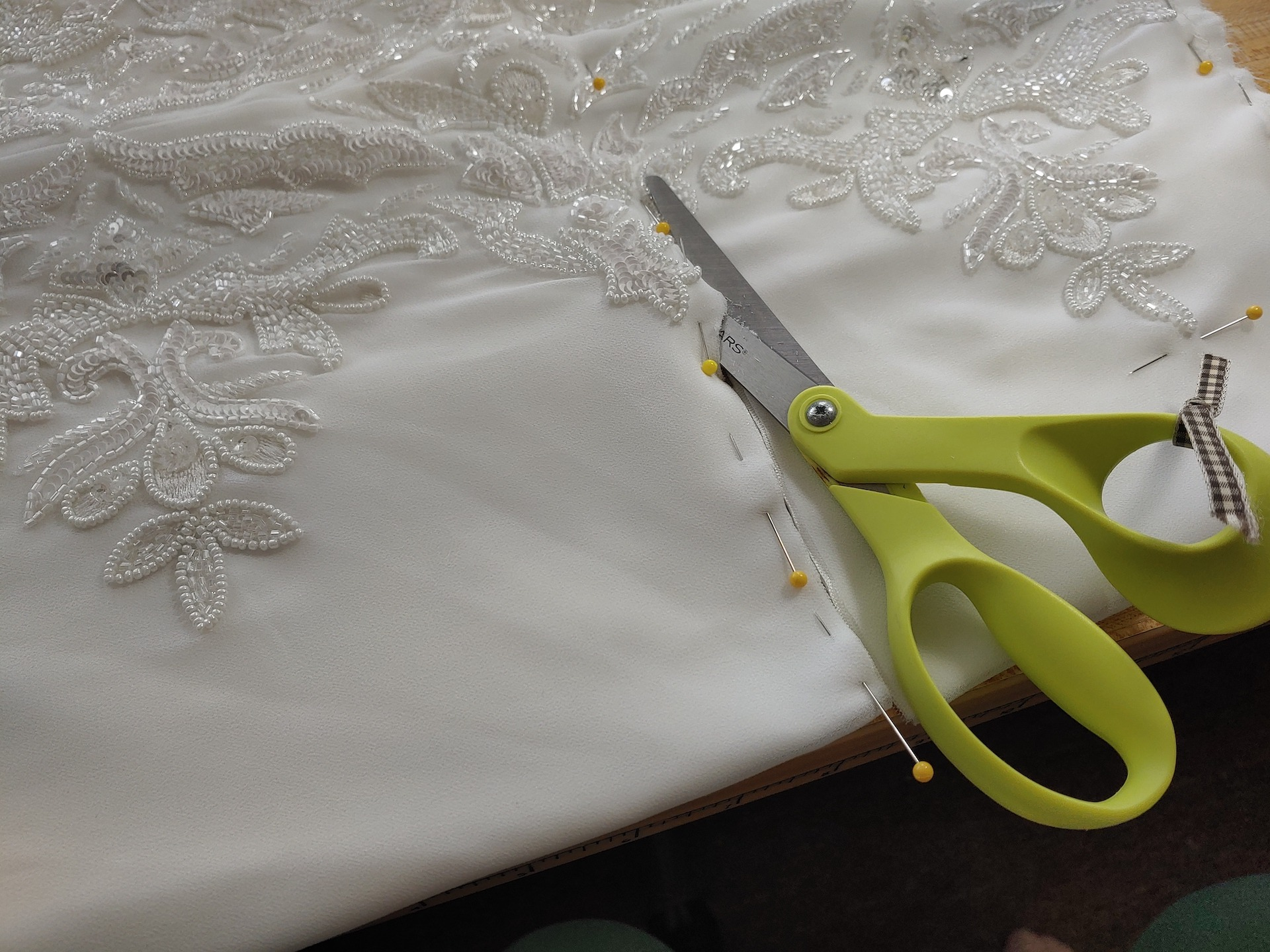 hemming from the waist with a pair fo scissors