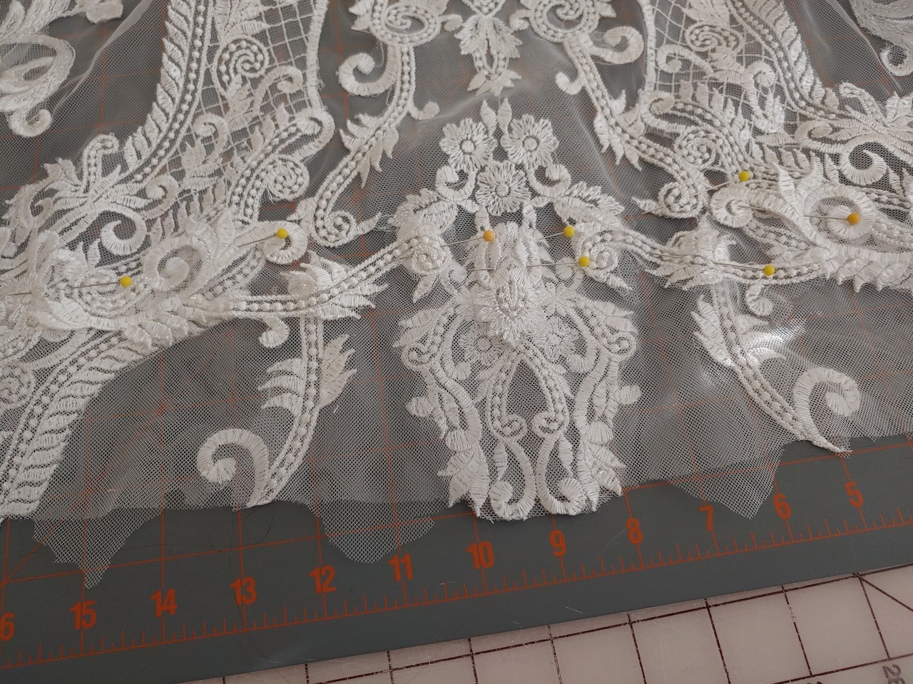 lace hem with netting border being measured