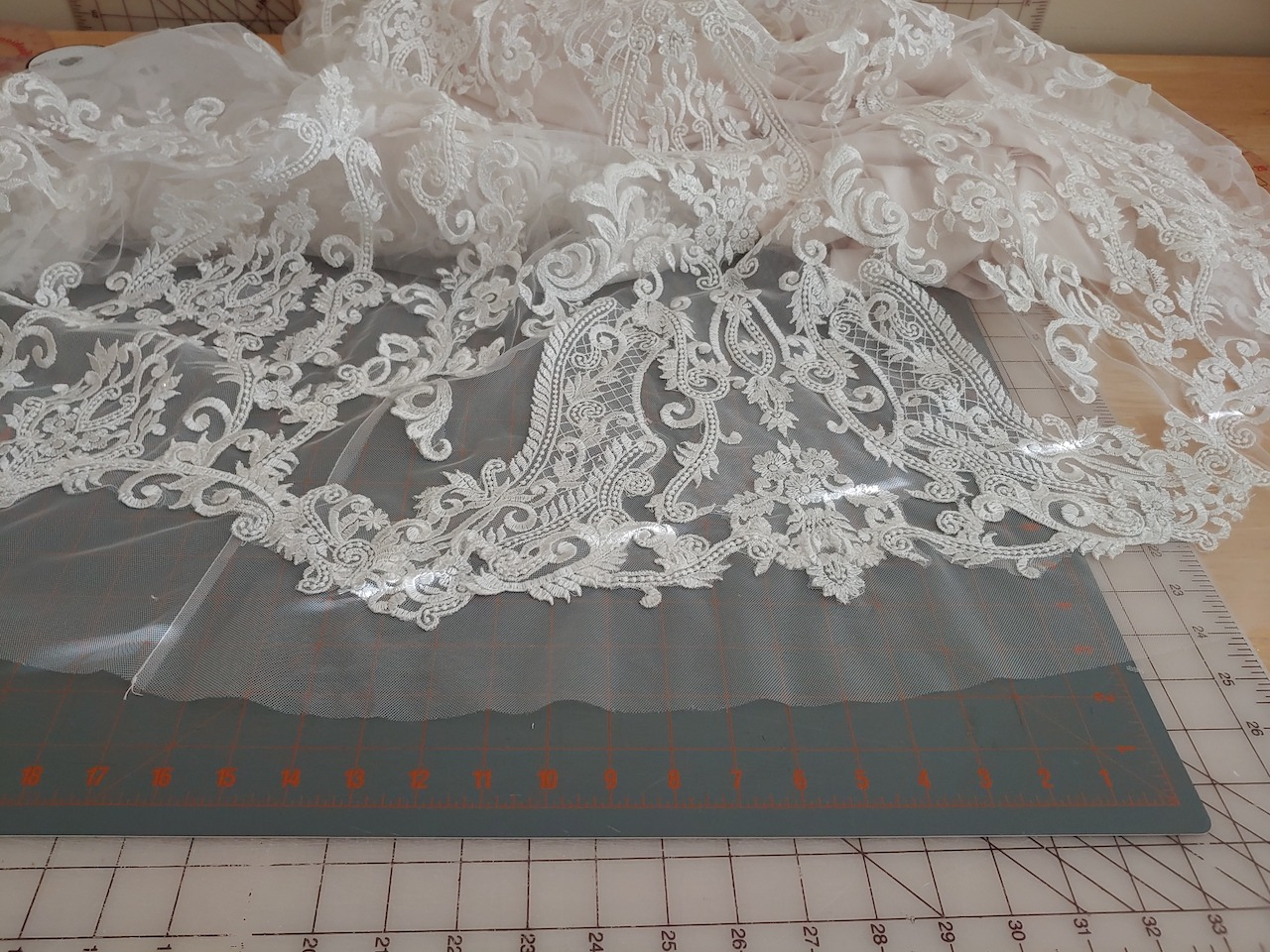 The hem of a wedding dress after alterations are completed