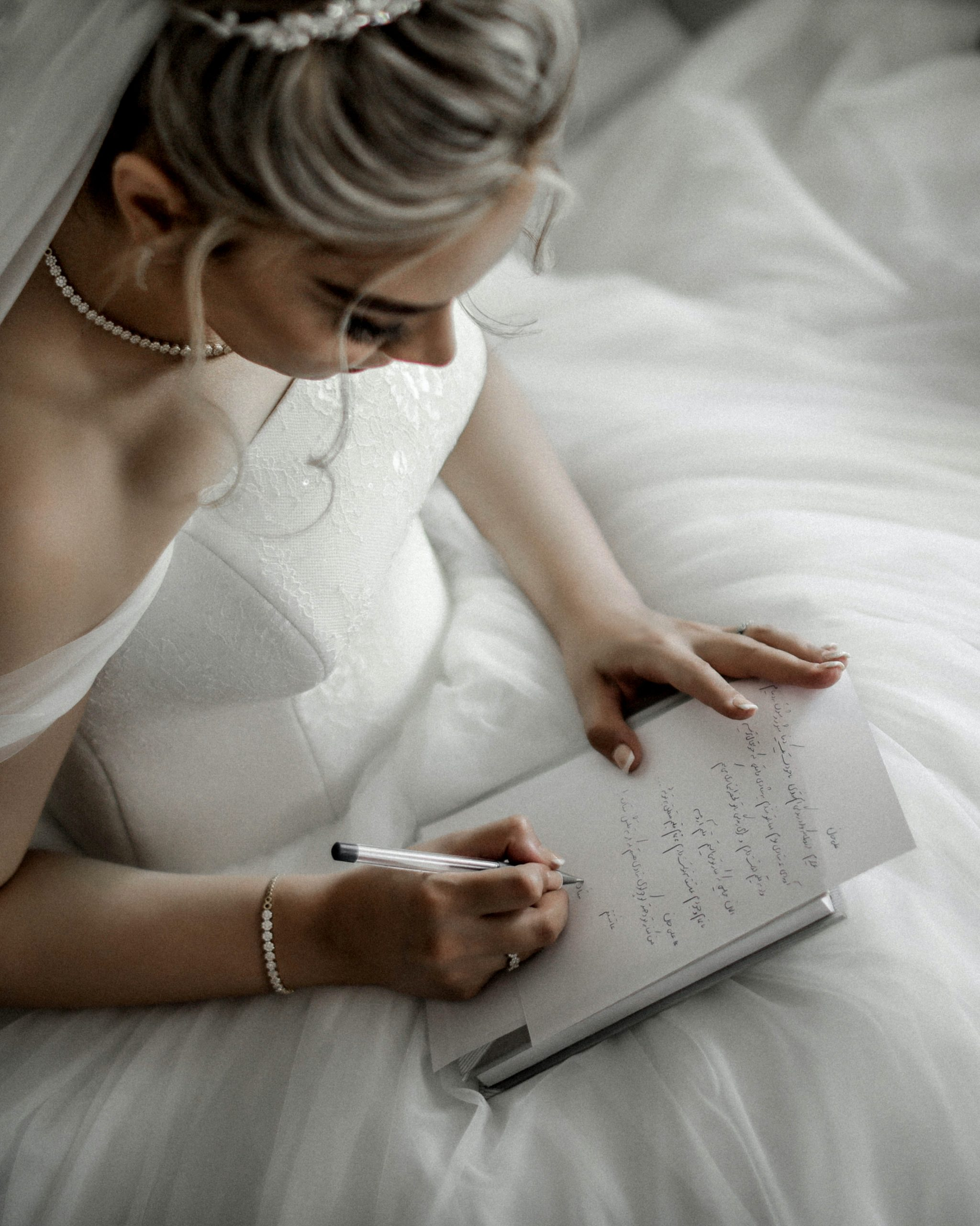 a woman in a wedding dress going down a checklist